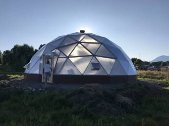 Guidestone 42' Growing Dome Greenhouse at sunset