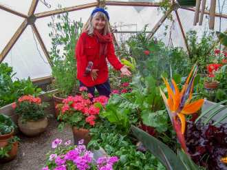 Puja Parsons in Growing Dome Greenhouse