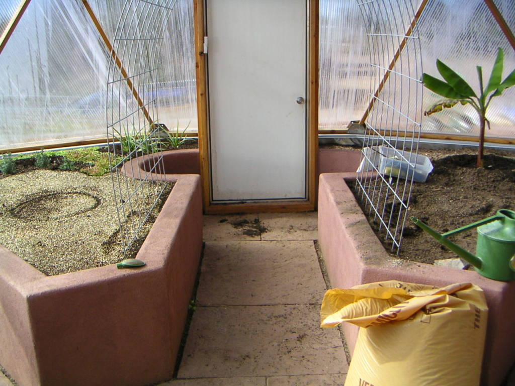 Aisle between raised beds in Growing Dome Greenhouse