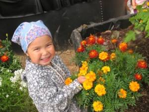 girl with flowers inside Growing Dome