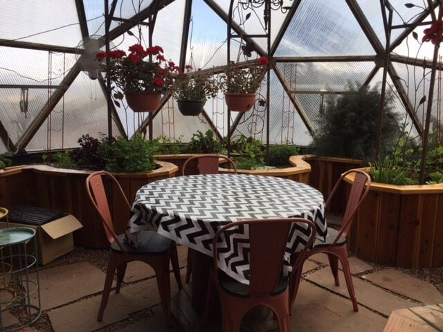 Patio Table in geodesic dome greenhouse