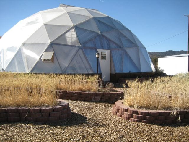 matching exterior planting beds outside geodesic dome greenhouse