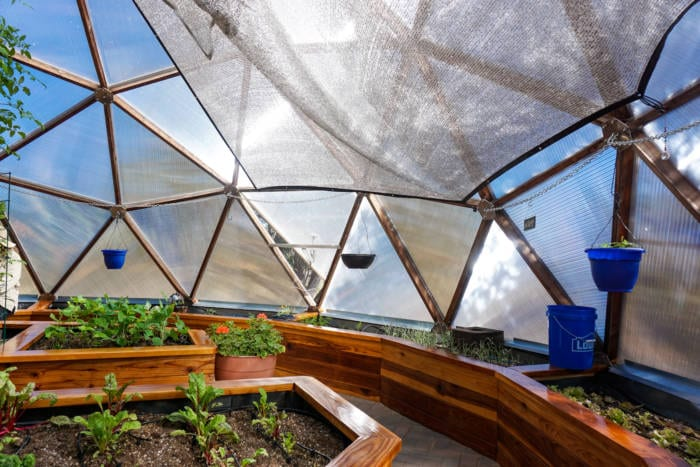 using the shade cloth to keep your greenhouse cool