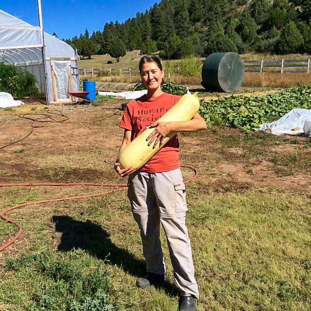 Growing Spaces gardener Heather Gray with a 24 pound zucchini