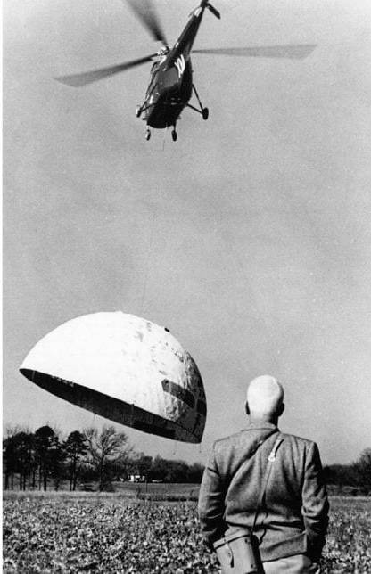 Buckinster Fuller geodesic dome being lifted by helicopter