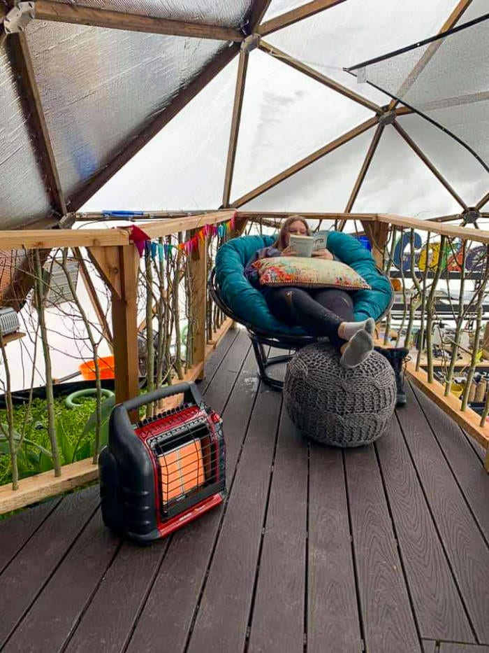 Deck above pond in geodesic dome