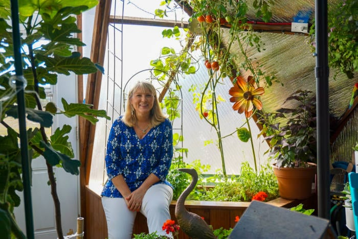 Caroline Swank in her custom greenhouse