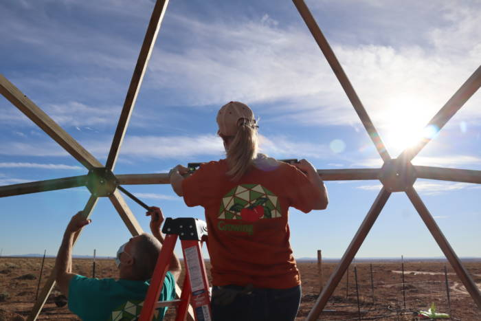 Liz Tingley working on a 26' Growing Dome build for Navajo Nation