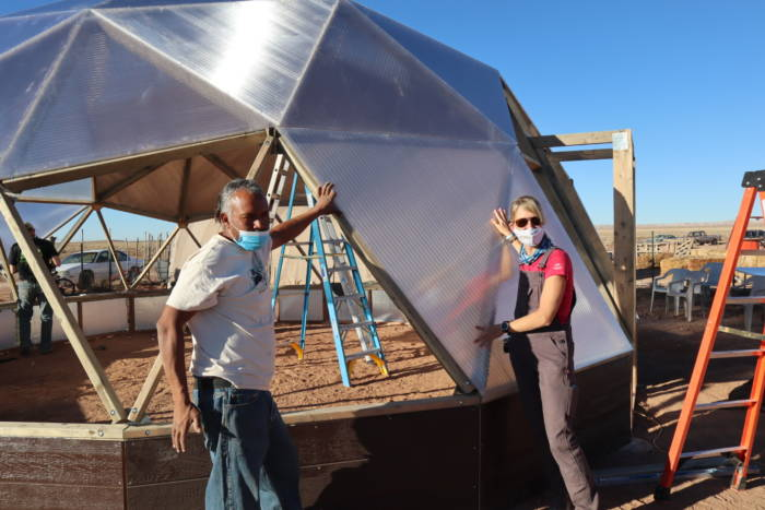 Tyrone Thompson and Megan installing a vent for the Growing Dome Greenhouse on Navajo Nation