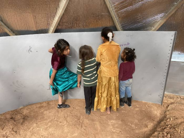Tyrone's family decorating the inside of the water tank