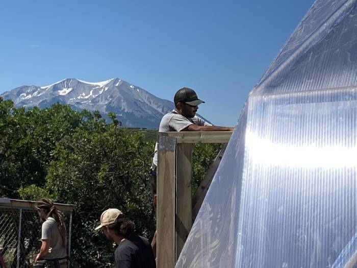 Growing Spaces Employee Installing a Growing Dome in Carbondale Colorado