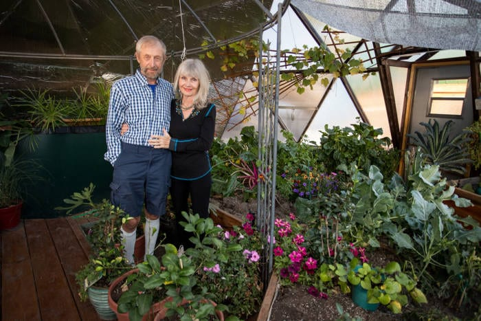 Udgar and Puja Parsons in their 22' Growing Dome Greenhouse